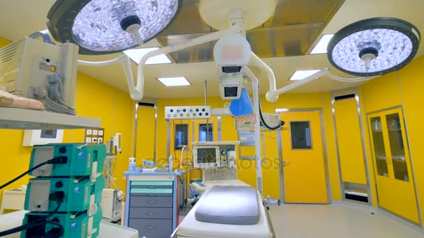 A small baby surgery table under bright lights.