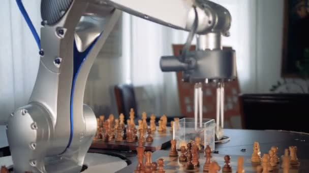 Futuristic chess robot playing ches moving figures on a chessboard.