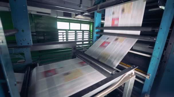 Printing machine with many newspapers. workshop of making newspaper.