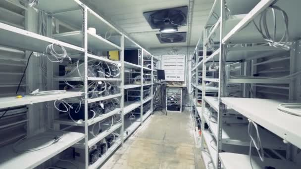 Server room for crypto currency mining  Row of bitcoin miners set up on the  wired shelfs  Mining cryptocurrency  Bitcoin farm  Machines for mining  cryptocurrency, bitcoin  Electronic device at day