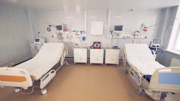 Hospital room with two beds and medical devices. 4K.