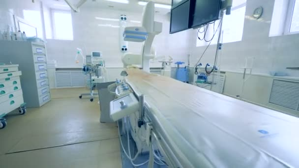 Empty operating table in a surgery room at a hospital. 4K.