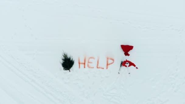 Top view of Santa Claus standing in a snowy field and calling for help