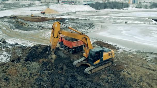 Quarry site with an excavator digging ground