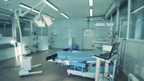 Solitary maternity ward with medical equipment in it