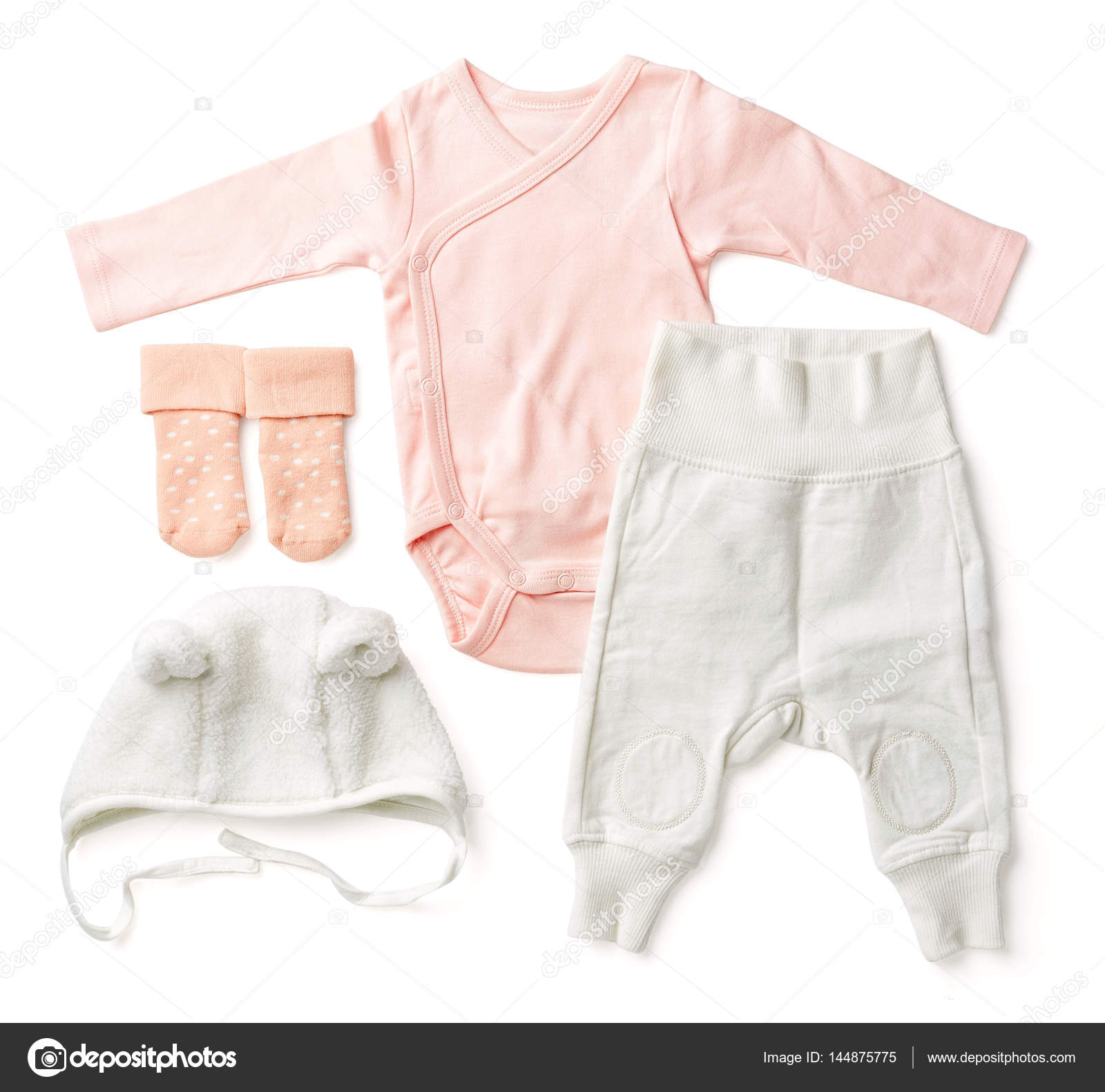 Set of pink baby clothes from above — Stock © bigacimail