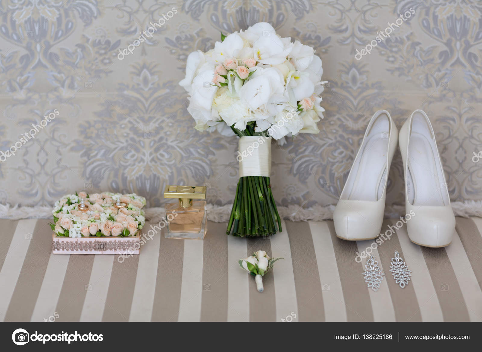 Wedding Bouquet Of White Orchids And Shoes Stock Photo