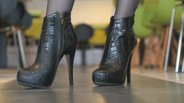 Girl advertises short boots from crocodile leather