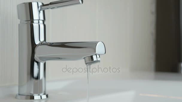 Water dripping from chrome-plated faucet — Stock Video ...