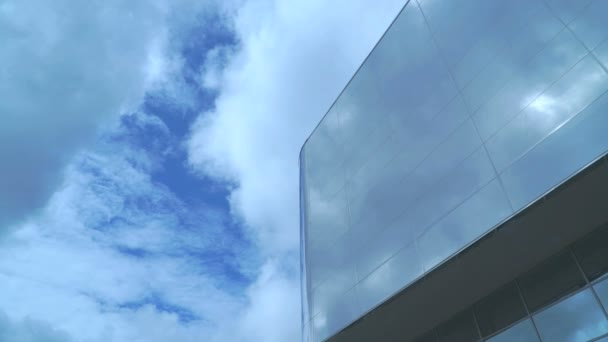 Skyscraper with reflective surface in sunny day