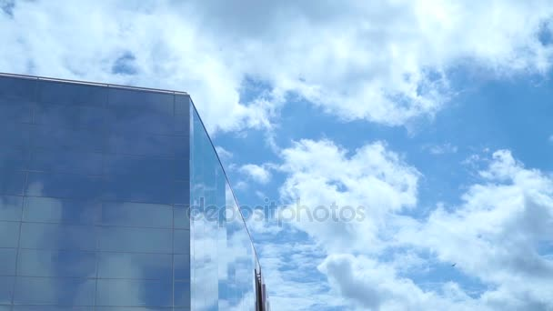 Timelapse of skyscraper with reflective surface