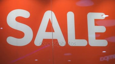 Word SALE in white color on red background