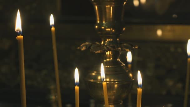 Candlestick with burning candles in the temple