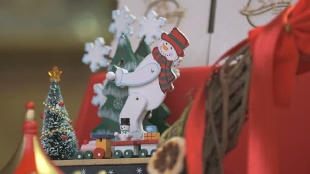 Christmas toy snowman spinning snowflakes