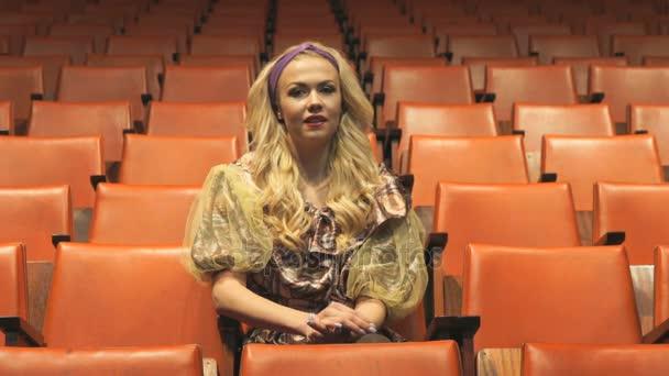 Beautiful woman sit in theater