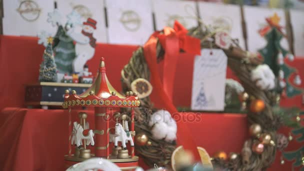 Close-up of New year souvenirs on shelf for sale