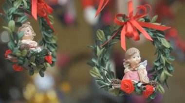 Two porcelain angels on red ribbons
