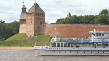Passenger ship with tourists floating on river