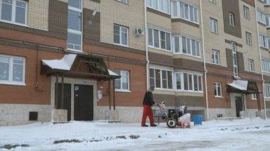 Man removing snow with snow plow machine