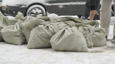 Unknown man taking bag with debris