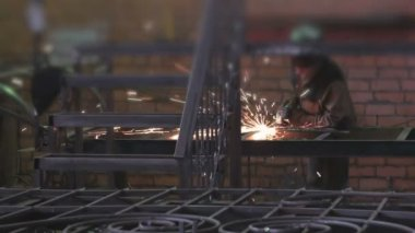 Man locksmith treating, polishing steel partitions