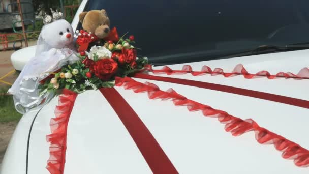 Wedding decoration on a white hood car outdoors