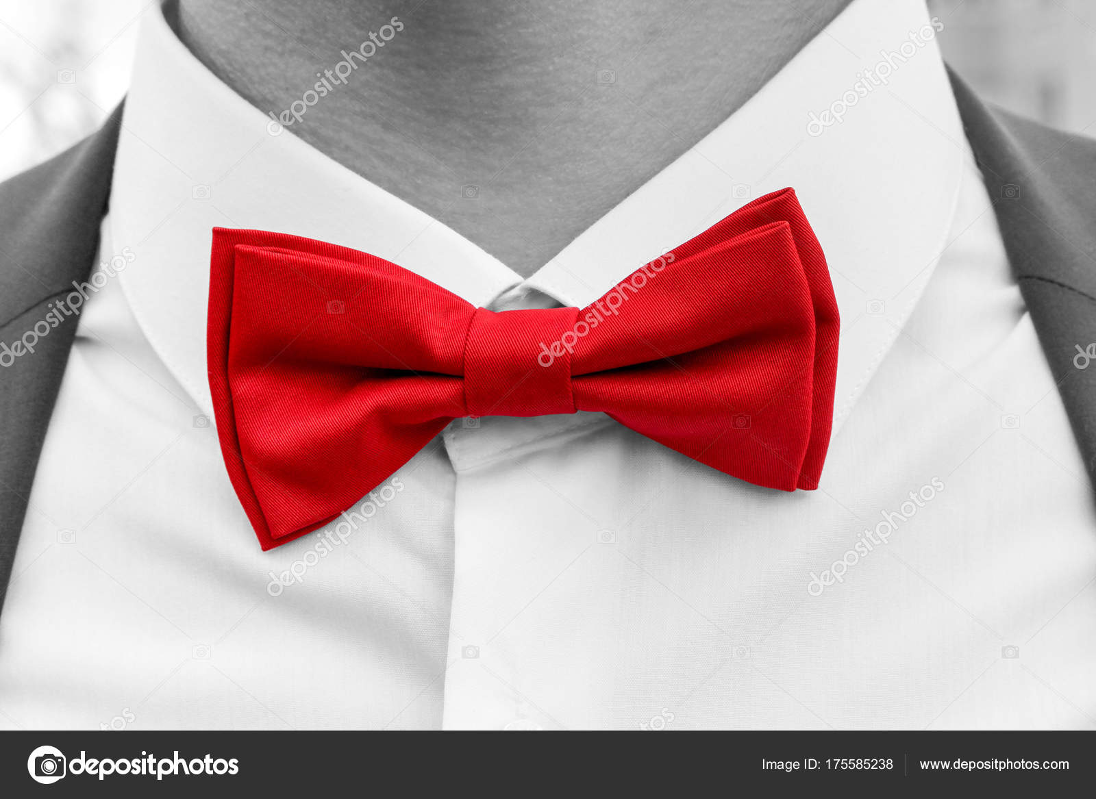 9644407f Red bow tie on neck of man, black and white photo with coloured element —