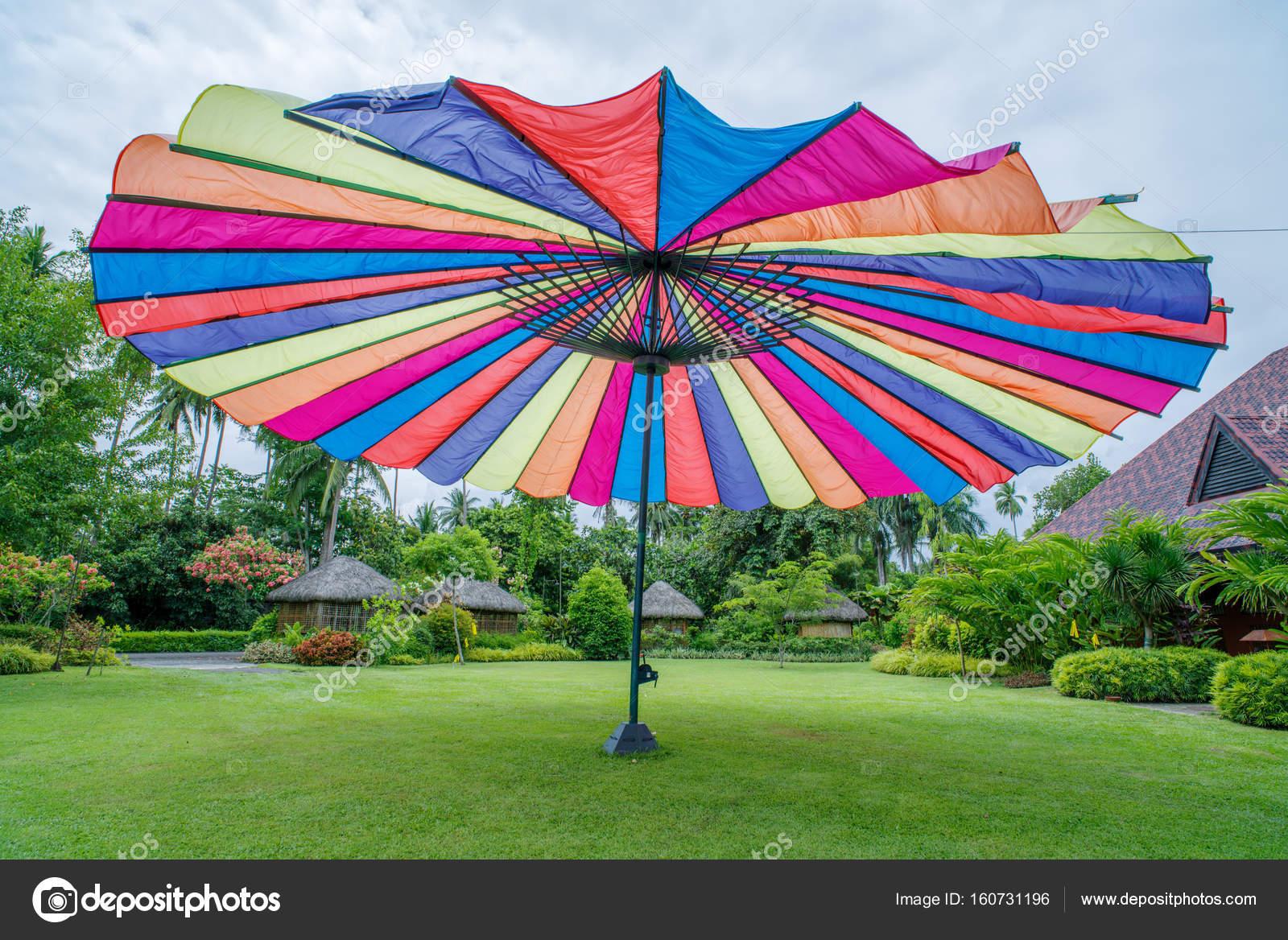 colorful big umbrella in the garden — Stock Photo © bugking88 #160731196