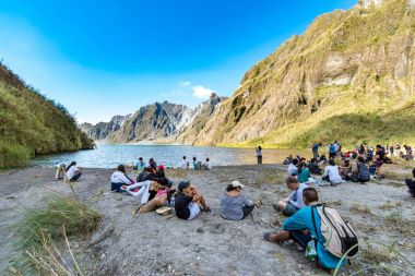 Feb 18,2018 Tourists and guides taking a break in front of Mt. Pinatubo crater lake, Capas