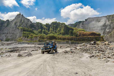 Feb 18,2018 Tourists on a Pinatubo tour in a four-wheel drive car, Capas