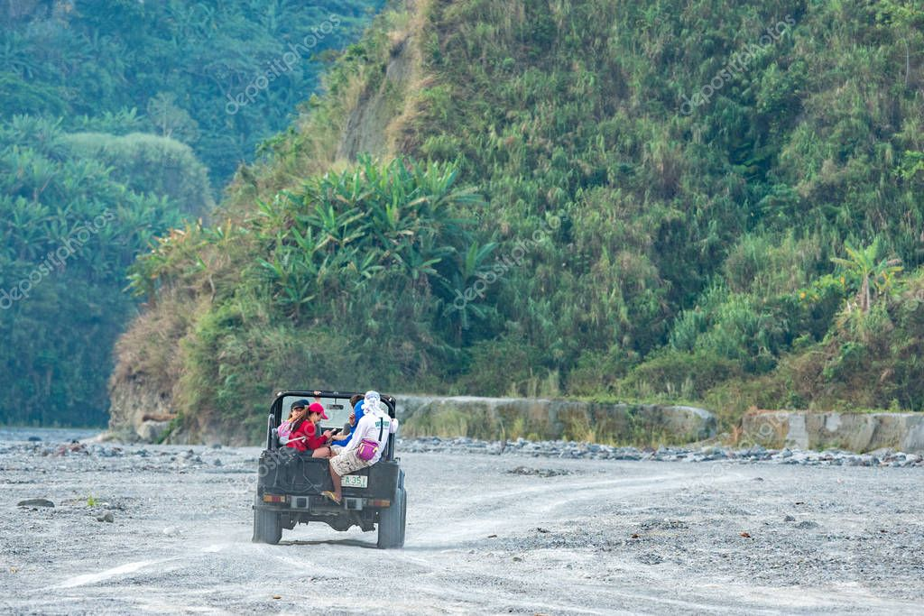 Feb 18,2018 Tourists on a Pinatubo tour in a four-wheel drive car, Capas