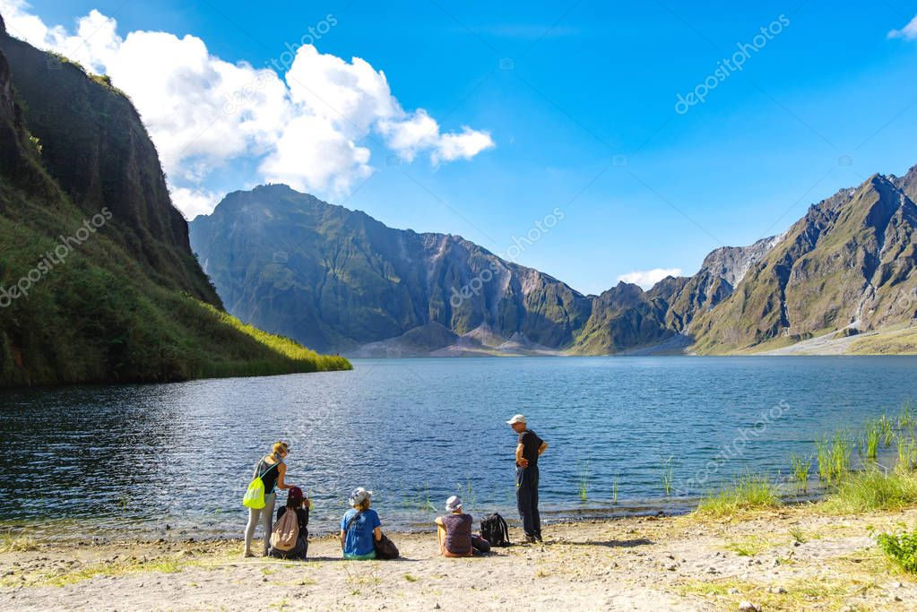 Feb 18,2018 Tourists taking a break in front of Mt. Pinatubo crater lake, Capas