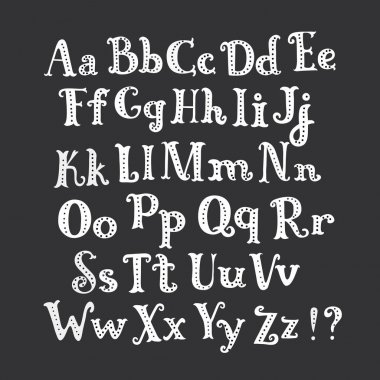 Halloween chalk roman alphabet. White hand-drawn letters set on dark background. Funny decorations of bats and pumpkin.