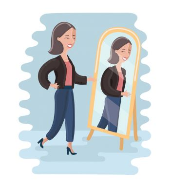 Young woman looking at herself in a mirror in dressing room.