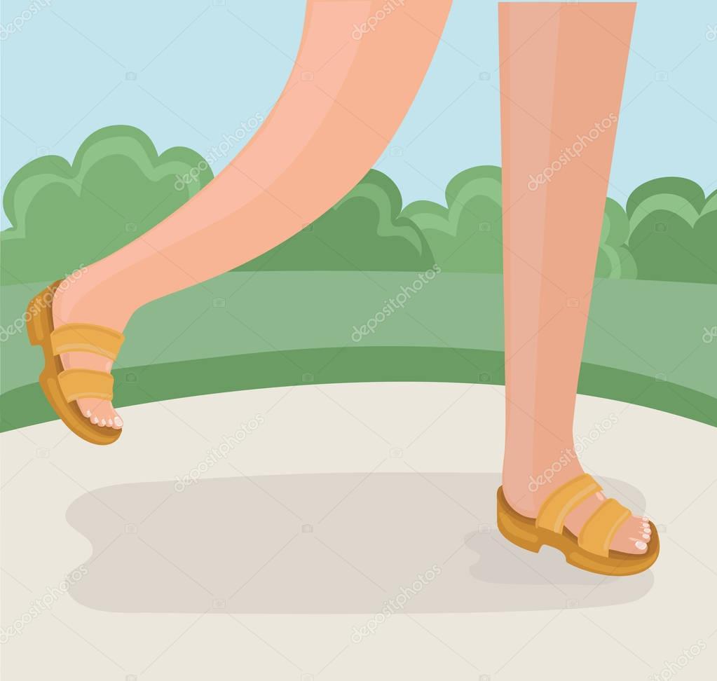 Legs of walking person.