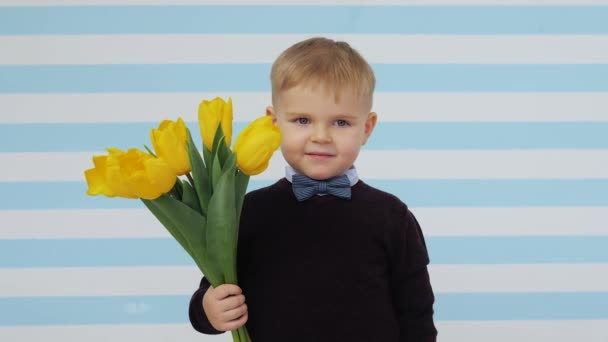 Happy. Smiling. Kids with flower. Studio. 8 march. Gift. Tulips.