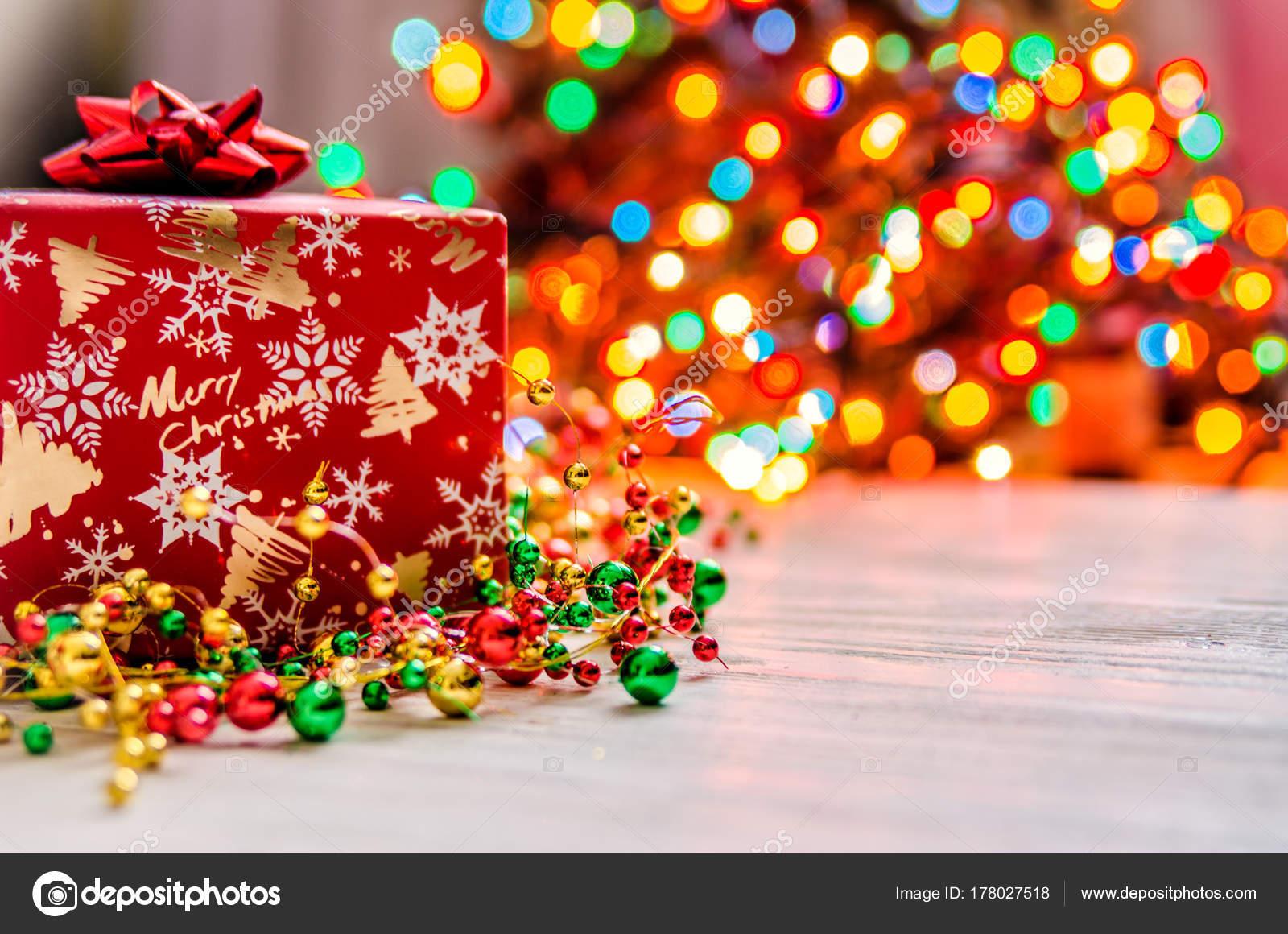 christmas present small bow background festive christmas lights stock photo