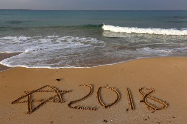 coast of the Mediterranean Sea in the north of Israel, congratulations on the new 2018 year