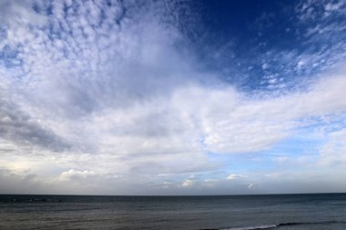 rain clouds floating in the sky over the Mediterranean Sea in the north of Israel