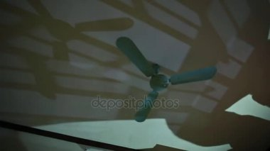 Retro ceiling fan on ceiling stock video alekseiptitsa 107730402 running the fan in the room at night a man leaves his shadow on the aloadofball Gallery