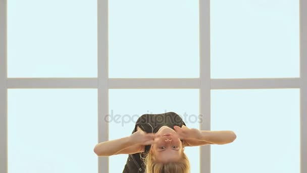 Beauty Teenage Girl Dancing. Against the background of a window in the form of a cage, cubes and squares. Joyful Teen Girl. Hairstyle.