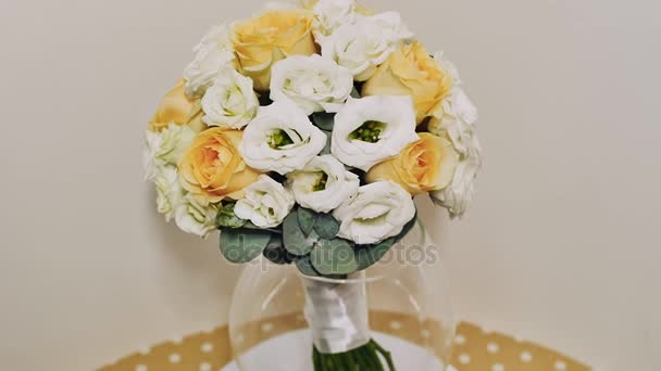 A wedding bouquet of yellow roses, eustoma and eucalyptus greens.. Bouquet in rotation.