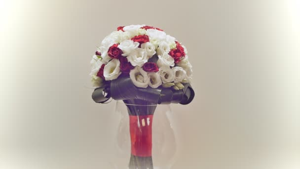 Wedding bouquet of rose bush, eustoma and greens. Bouquet in rotation.