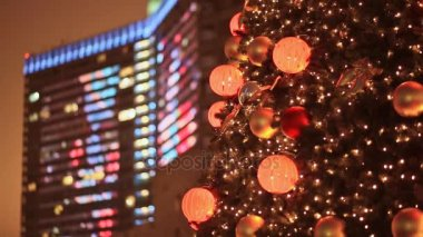 Christmas decorations on the street. Glowing windows of architectural high-rise buildings. Street illumination. Buildings of the New Arbat in the background. New Year theme.