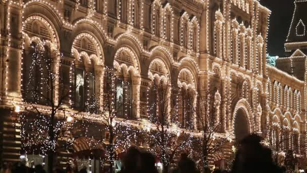 architectural buildings in moscow at night in festive illumination walking passers by new