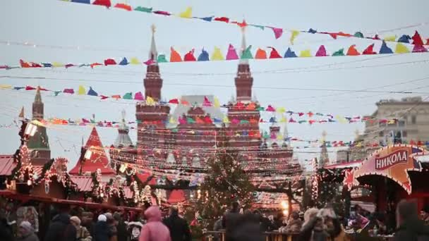 MOSCOW, RUSSIA - JANUARY 1, 2017: People at the Christmas market on Red Square in the center of Moscow. Decorated Red Square for Christmas. Fair. New Year theme.