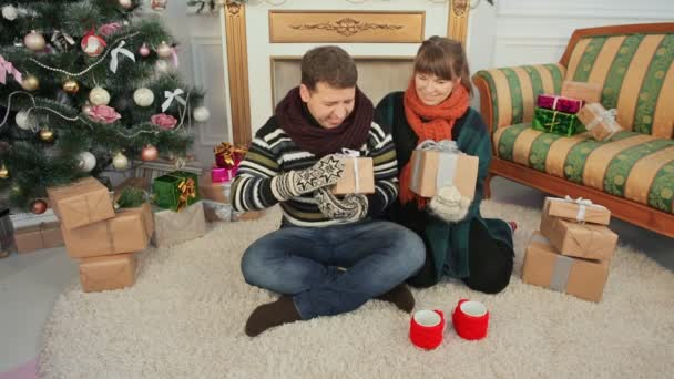 a young girl and a boyfriend exchange christmas gifts christmas and new year themes