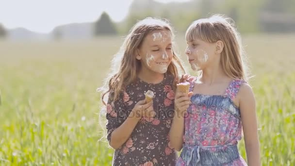 Two Girls Sister Eat Ice Cream In The Summer Next To A Field Village Face Is Soaked Funny Episode Stock Footage
