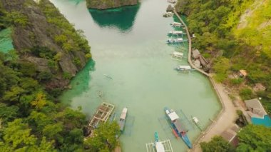 Very beautyful lagoon with boats. Paradise islands in Philippines. Kayangan Lake.