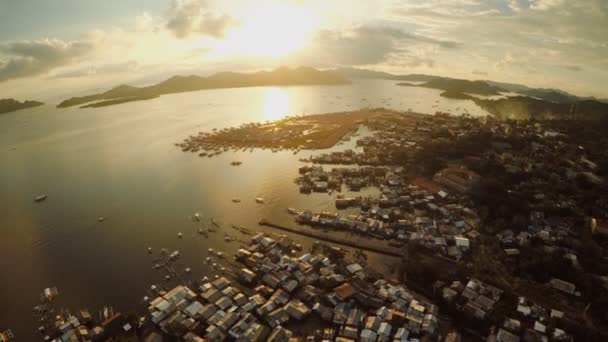 Aerial view Coron city with slums and poor district. Palawan. Busuanga island. Evening time and sunset. Fisheye view.